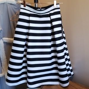 Skirt with black and white stripes.